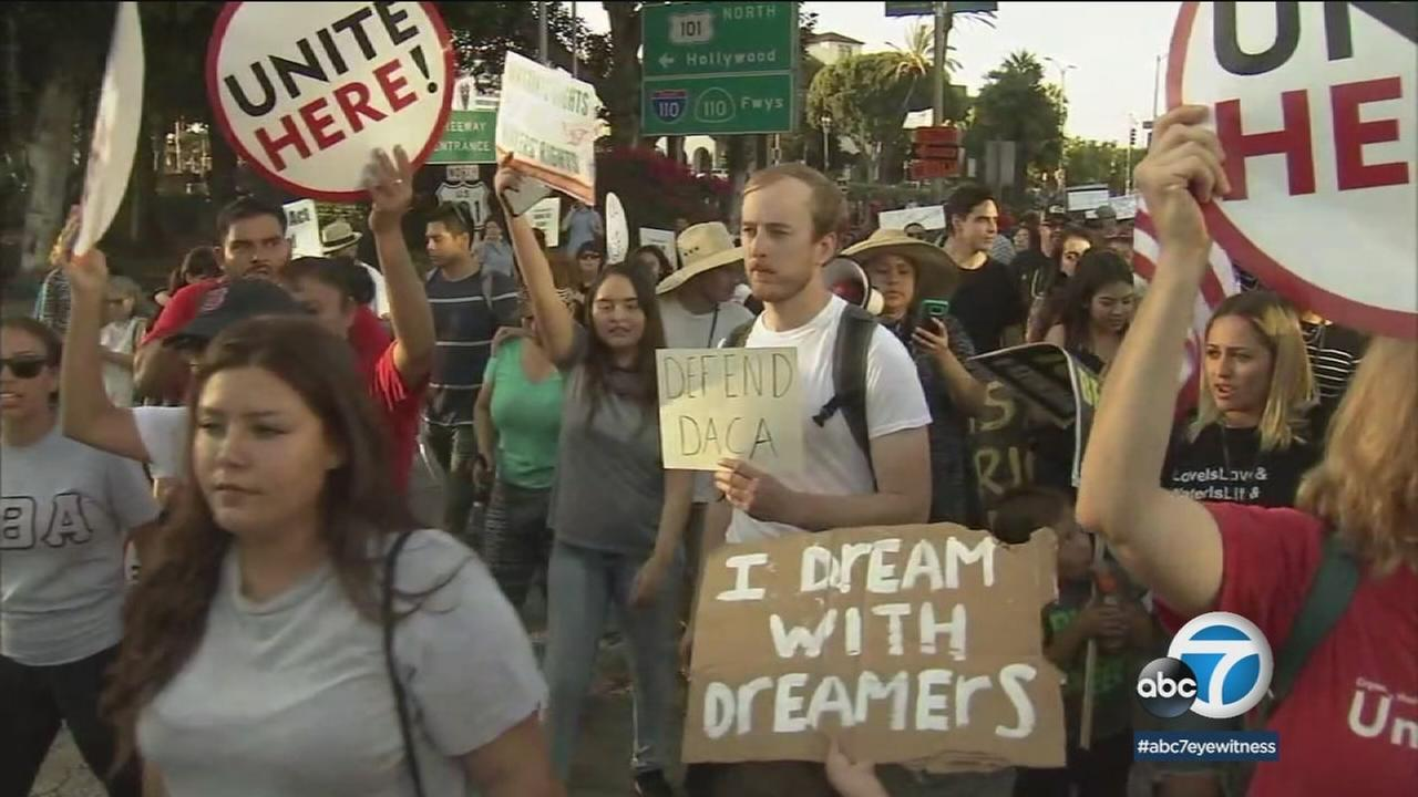 Protesters hold signs for protections on DACA as judges get ready to look over ending the program based on the Trump administrations decision.