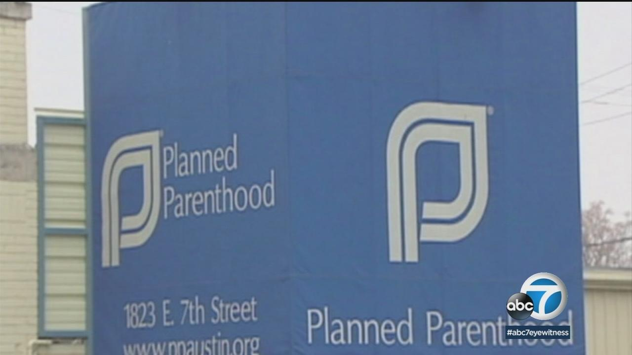 A sign for Planned Parenthood is shown in a photo.