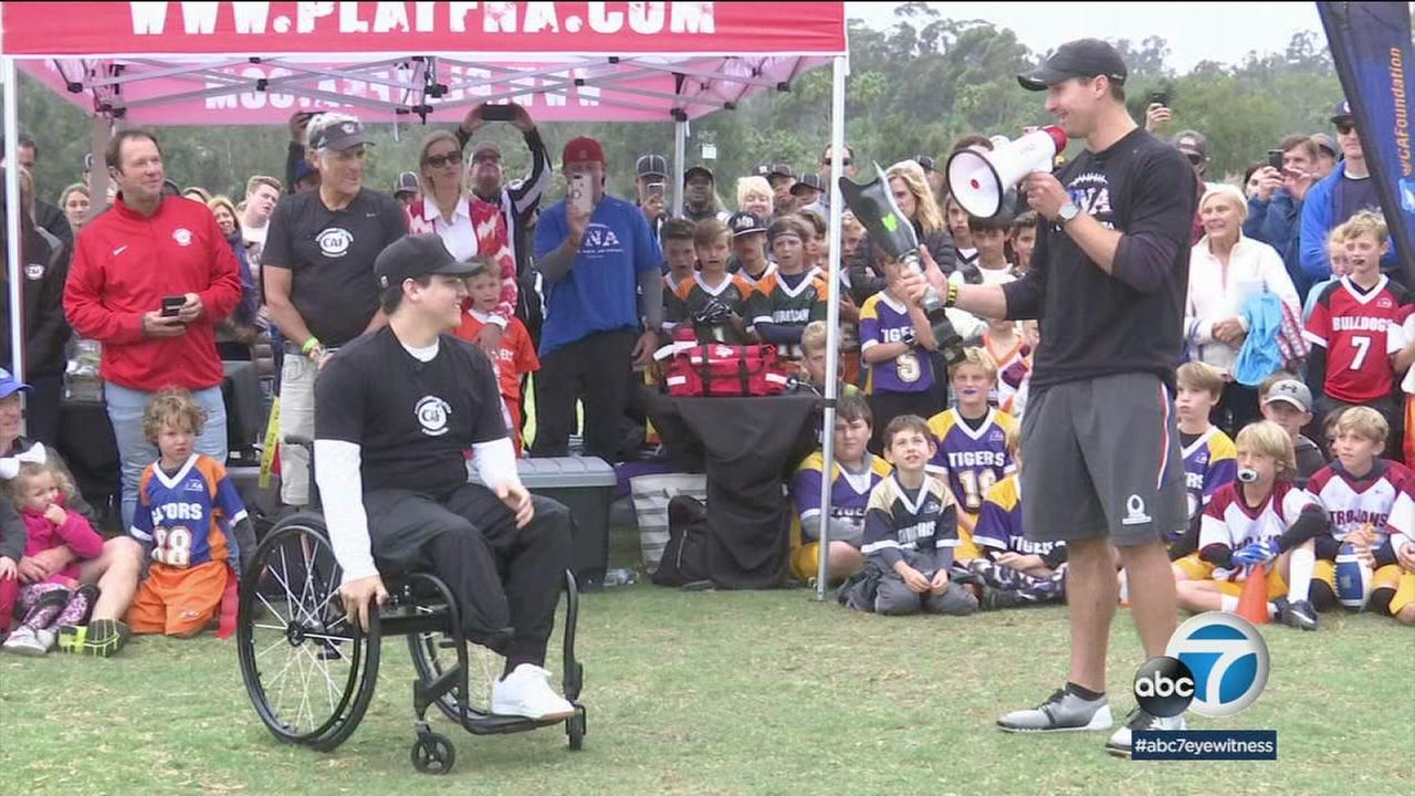 NFL player Drew Brees presents a walking prosthetic leg to Temecula student athlete Alex Ruiz.