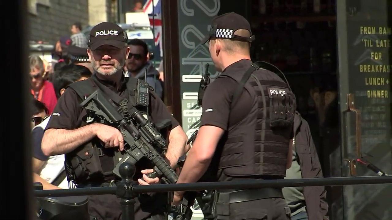 British police are shown walking around London.