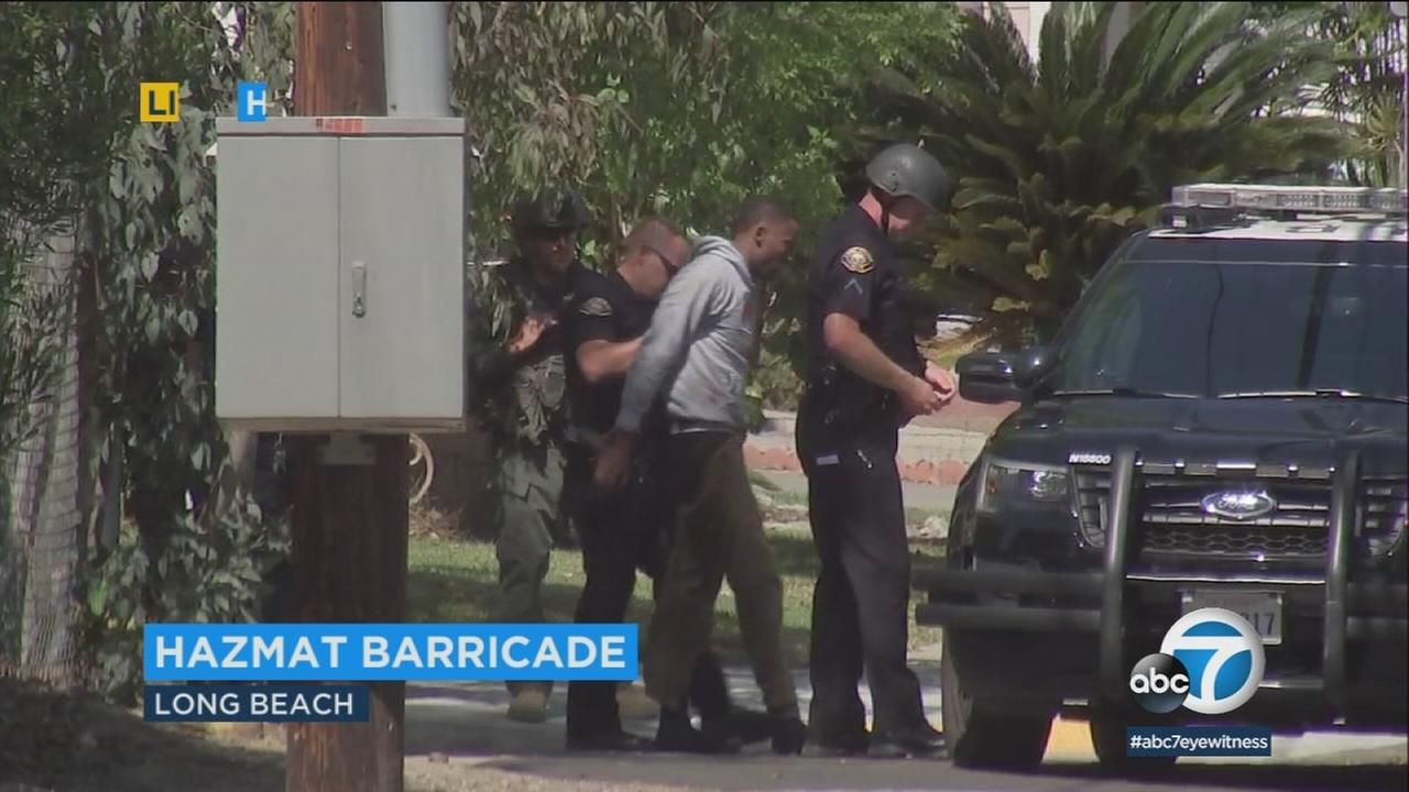 A police SWAT team was involved in an hourslong standoff at a home in Long Beach where three would-be burglars were taken into custody.