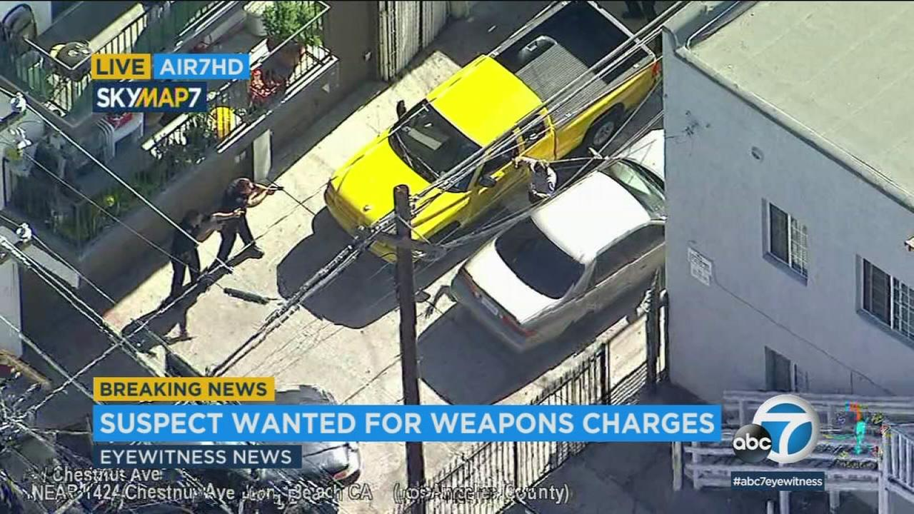 A chase suspect is shown surrendering to police following a slow-speed chase in Long Beach.