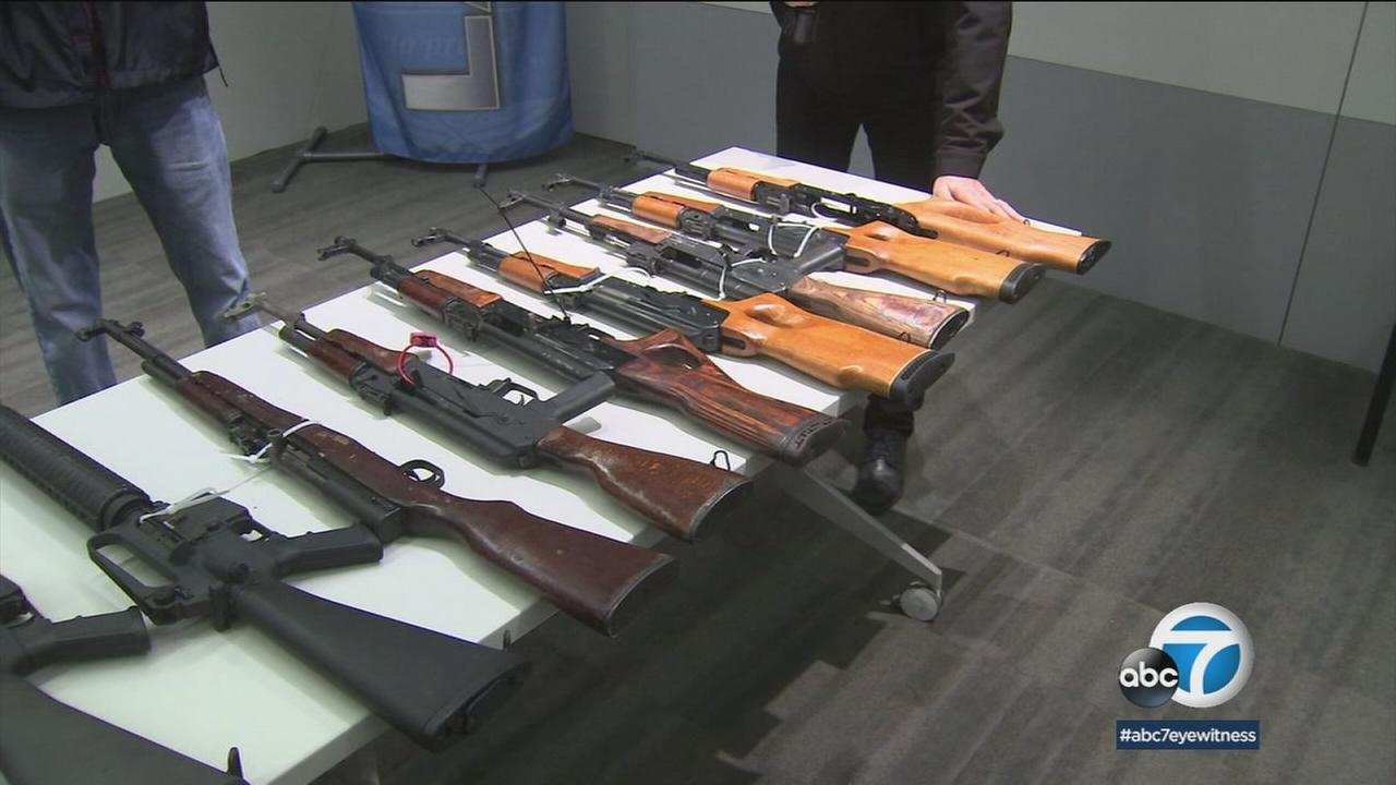 Gun owners handed over their weapons to police on Saturday as part of a gun buyback program in Los Angeles.