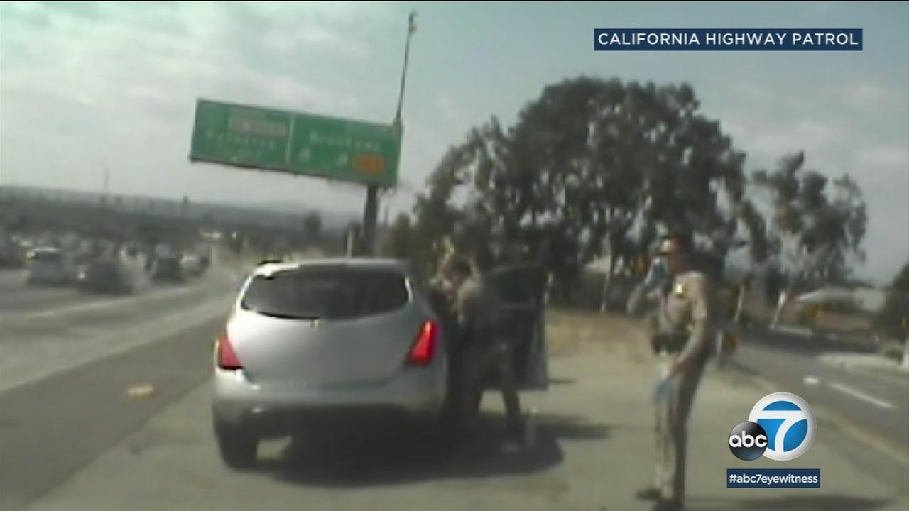 Dashcam video shows the moment two CHP officers came to the rescue of a woman giving birth on Interstate 5.