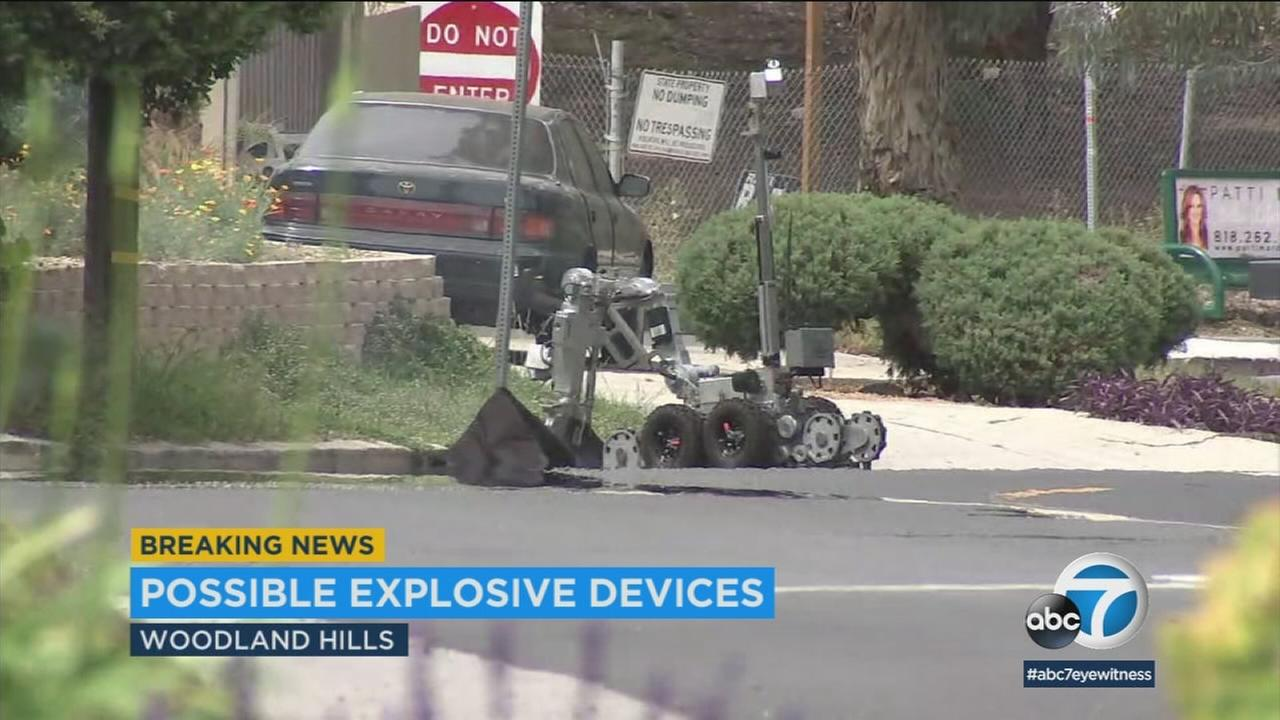 Los Angeles police called out the bomb squad after finding one or more suspicious devices in a stolen car that was pulled over off the 101 Freeway in Woodland Hills.