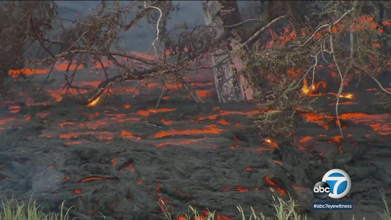 Lava seen flowing near homes in Hawaii.