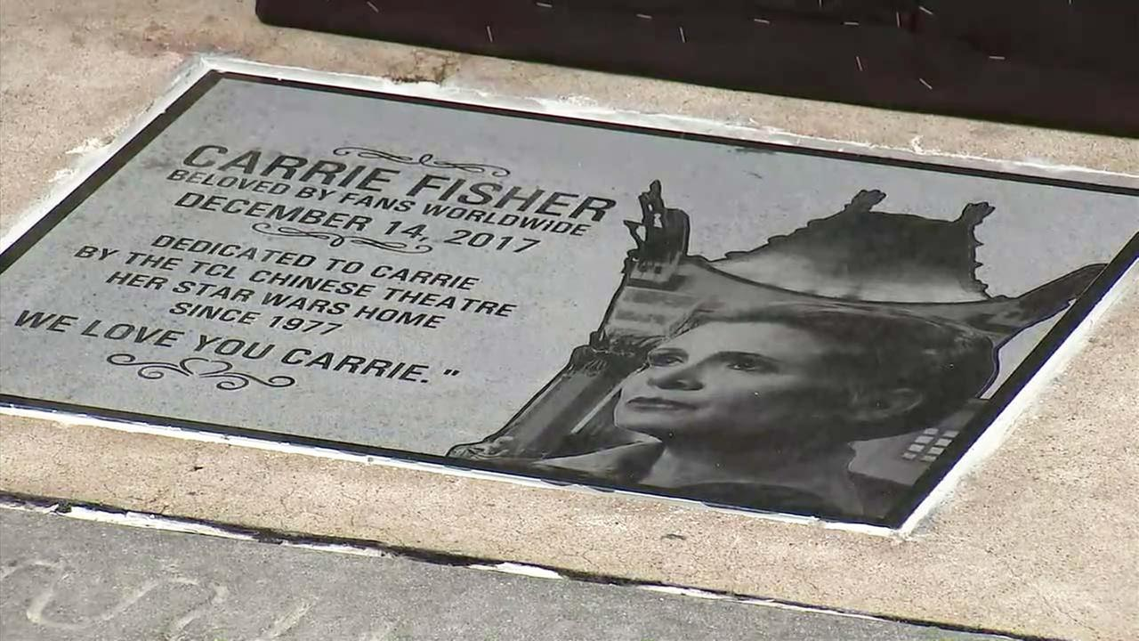 A commemorative stone plaque honoring late actress Carrie Fisher was unveiled outside TCL Chinese Theatre in Hollywood on Thursday, May 24, 2018.