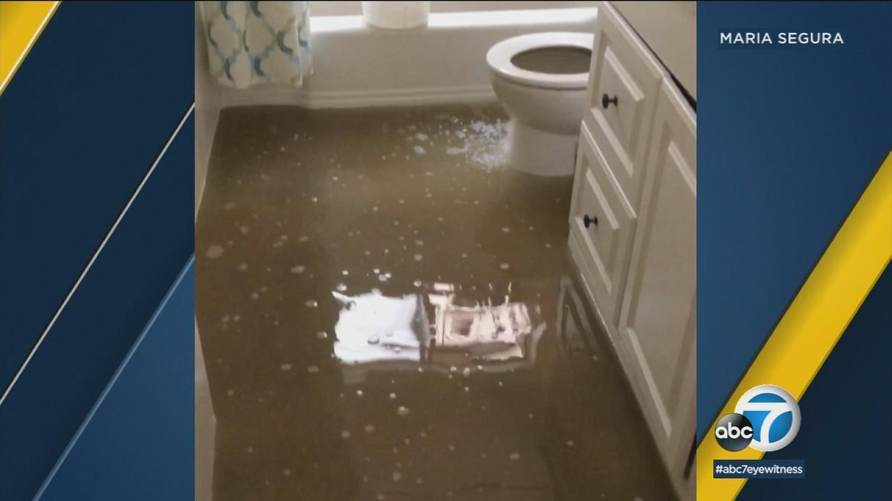 Residents in San Gabriel dealt with a stinky situation as a river of sludge invaded homes due to a backup in the sewer system Wednesday night.