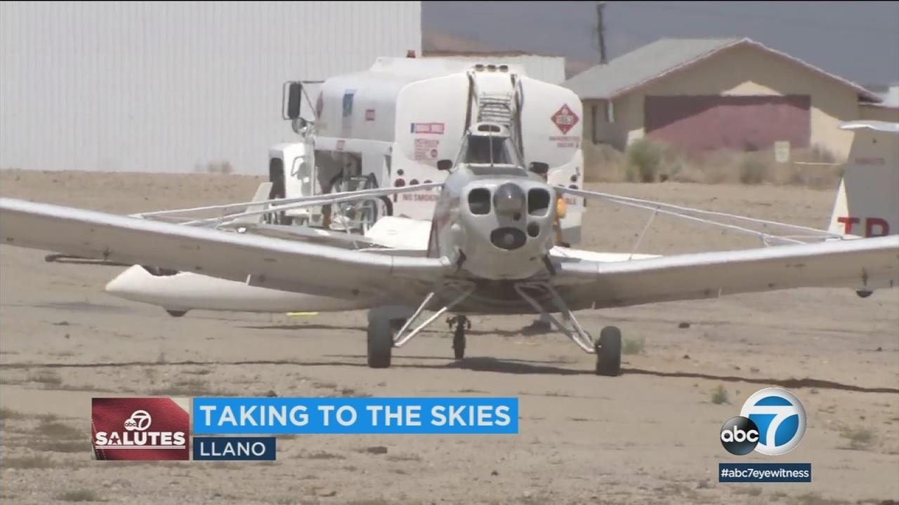 A plane takes off from Llano to do a glider flight for disabled veterans.