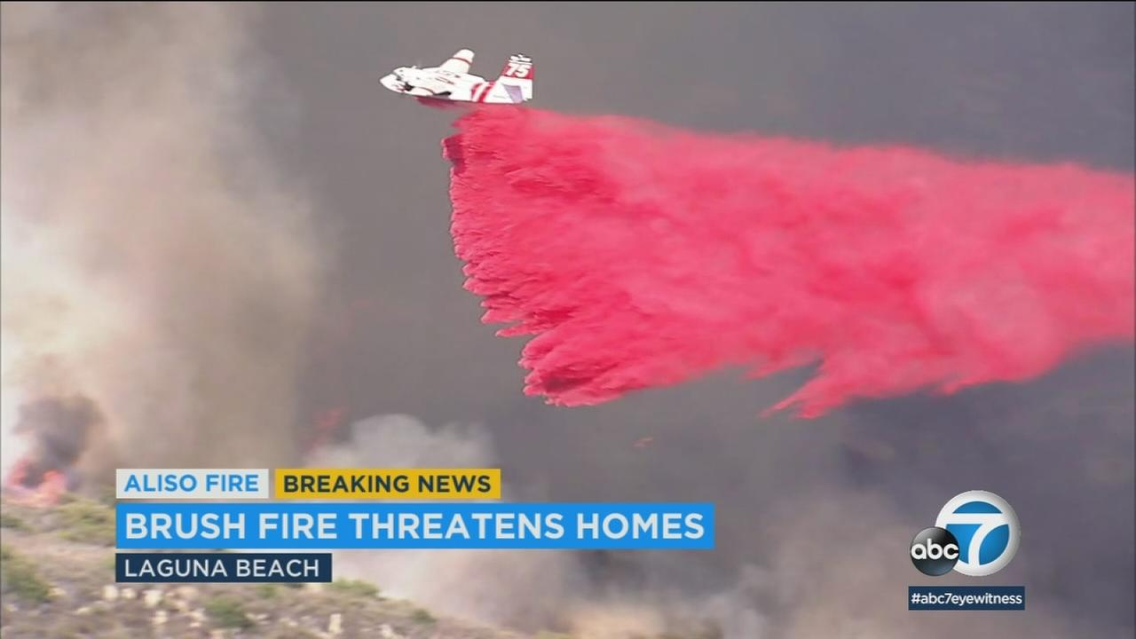 Firefighters drop fire retardant amid a 200-acre brush fire in the Laguna Beach area on Saturday, June 2, 2018.
