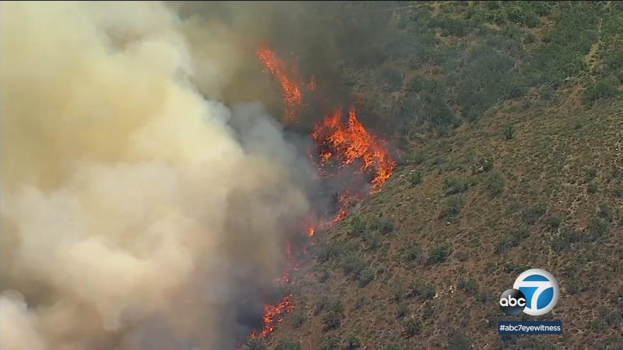 Evacuations were ordered in the Agua Dulce area as a brush fire fueled by winds and high temperatures threatened structures on Monday.