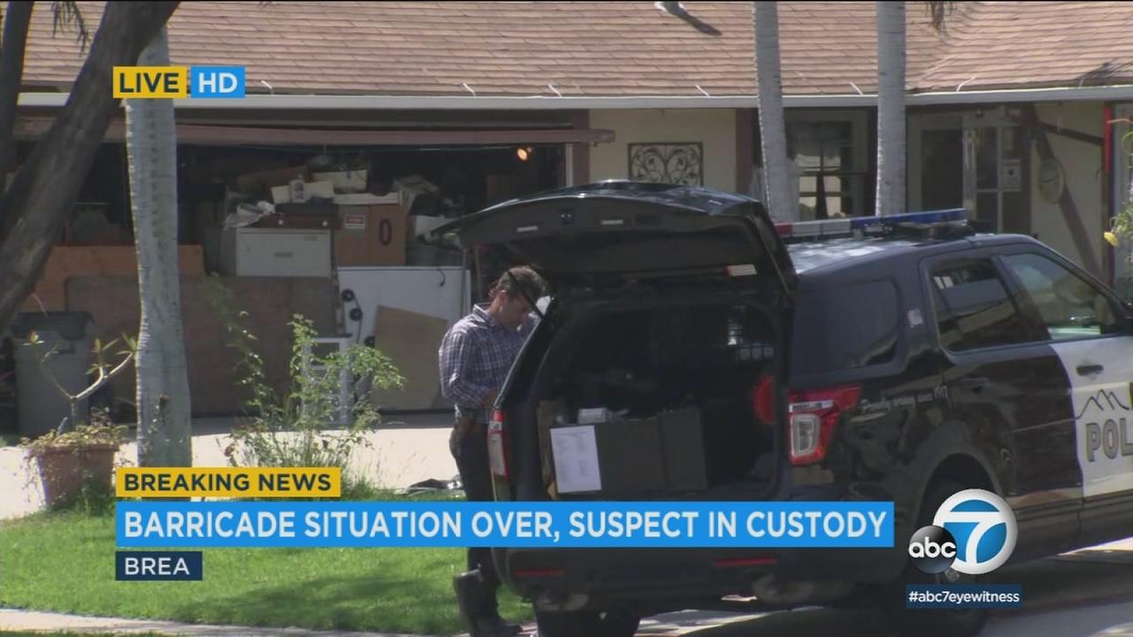 A man who tried to stuff a woman into the back of a van is facing felony assault charges after surrendering to a SWAT team following a four-hour standoff in Brea Friday.