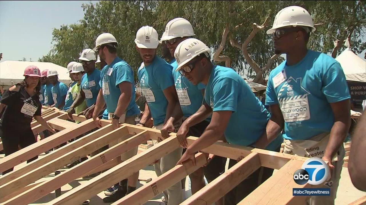 Los Angeles Rams rookies put the hammer down for a good cause on Friday as they helped build six homes in Culver City.