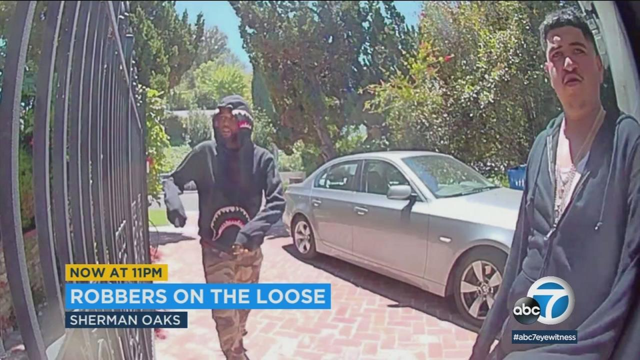 These possible burglary suspects were captured on surveillance video in Sherman Oaks.