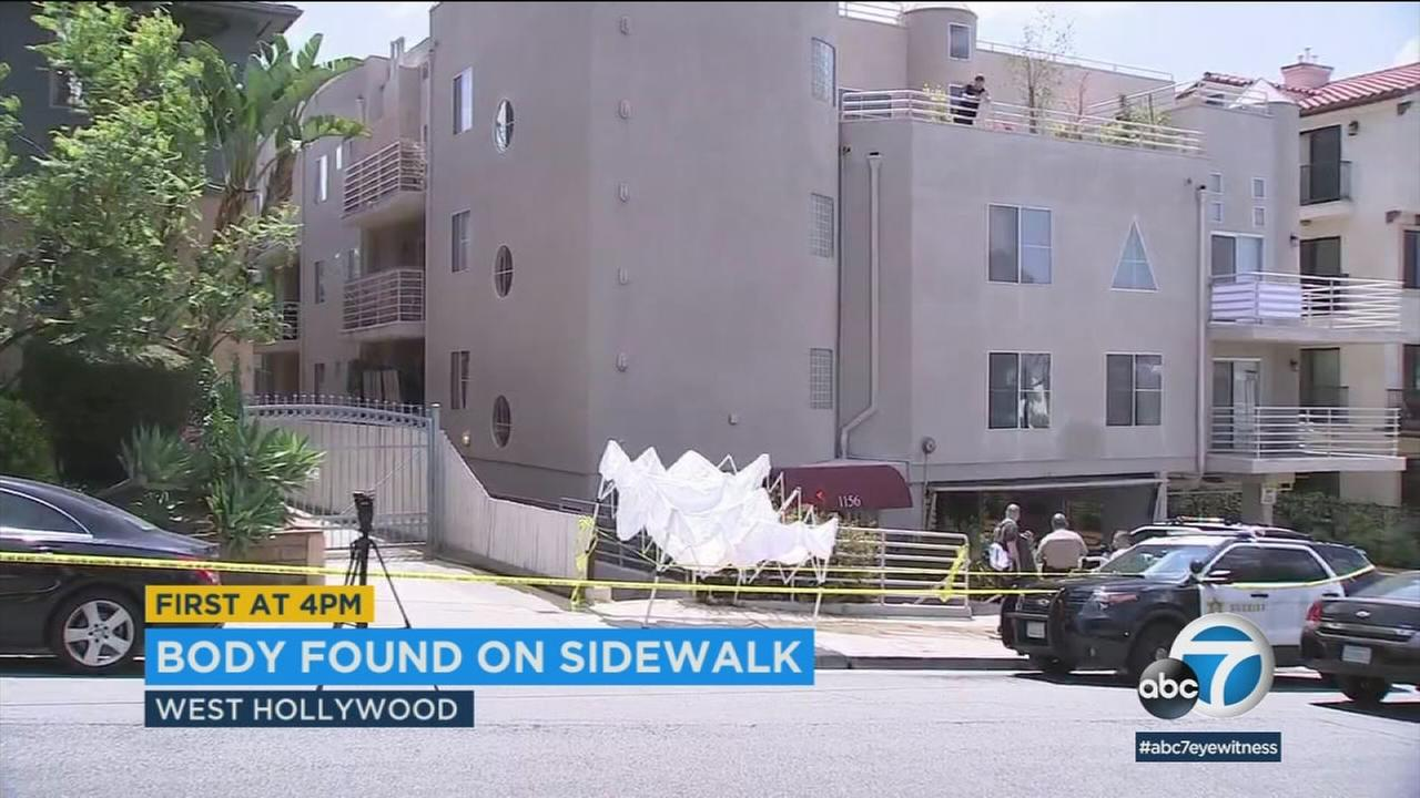 Authorities surrounded an area where a mans body was found after hed fallen out of a West Hollywood apartment window on Monday, June 18, 2018.