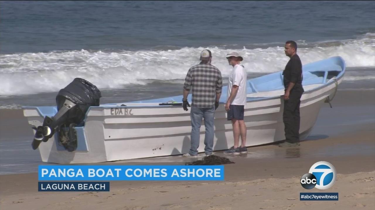 A panga boat washed ashore in Laguna Beach on Tuesday, June 19, 2018.