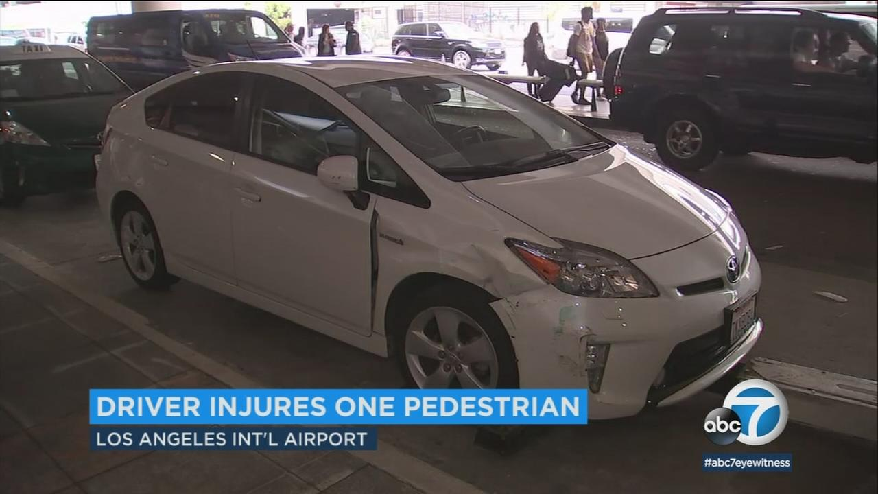 A driver at LAX swerved off the road Thursday, injuring a pedestrian before crashing into a bus bench.