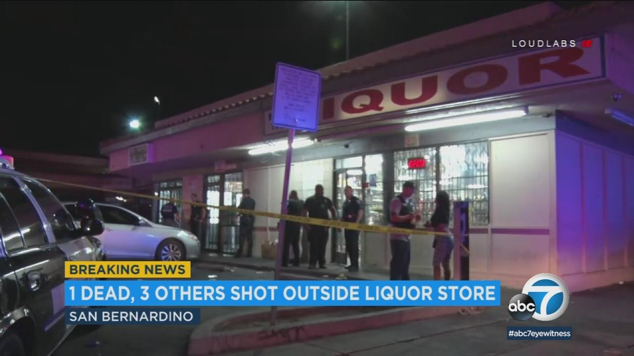 A liquor store where four people were shot and one was killed is shown in a photo.
