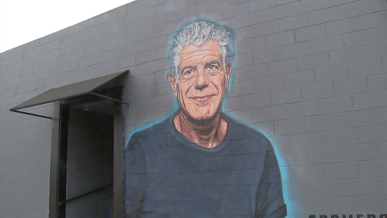 A mural of famed chef Anthony Bourdain is shown on the side of the Grammercy Restaurant along Wilshire Boulevard in Los Angeles.