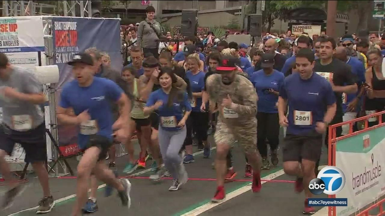 People begin running for the Shatterproof 5K in downtown Los Angeles.