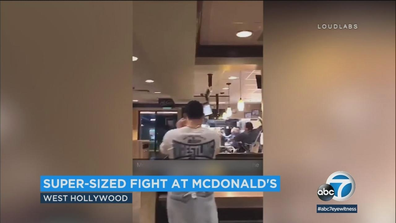 Video shows a wild scene between a customer and employees throwing food items at each other inside a McDonalds in West Hollywood.
