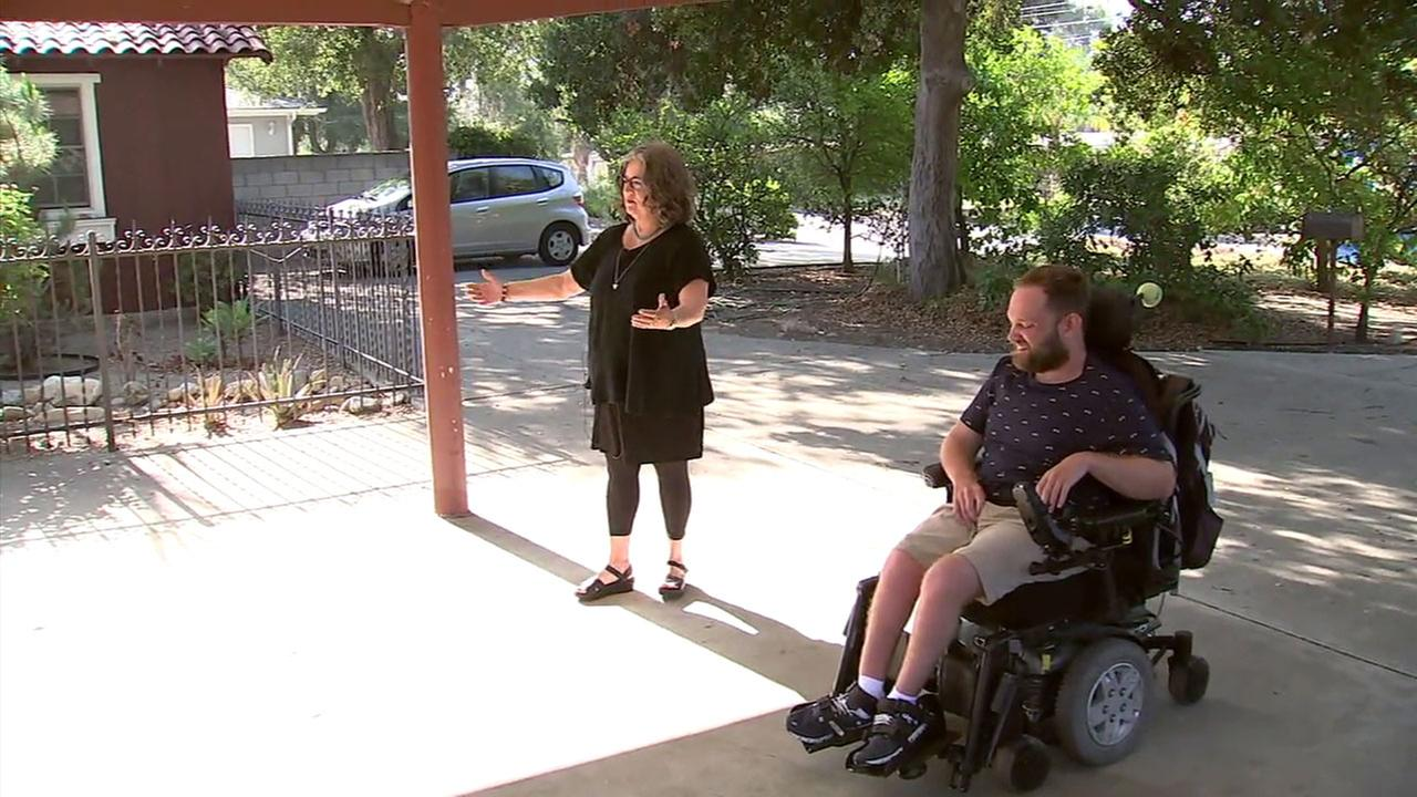 Quinn Klingerman, a Claremont man with cerebral palsy, and his mother Sheila James show where his accessible van was stolen from his home.