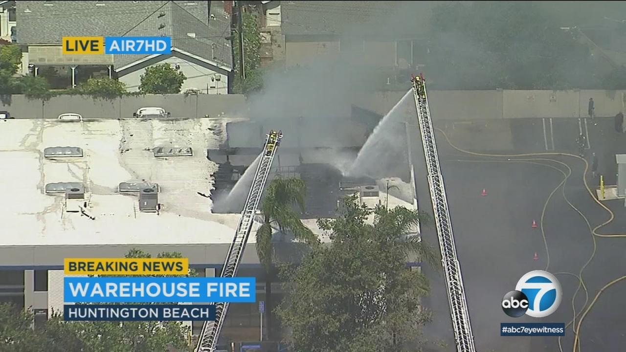 Firefighters were battling a 3-alarm fire at a golf warehouse in Huntington Beach on Wednesday morning.