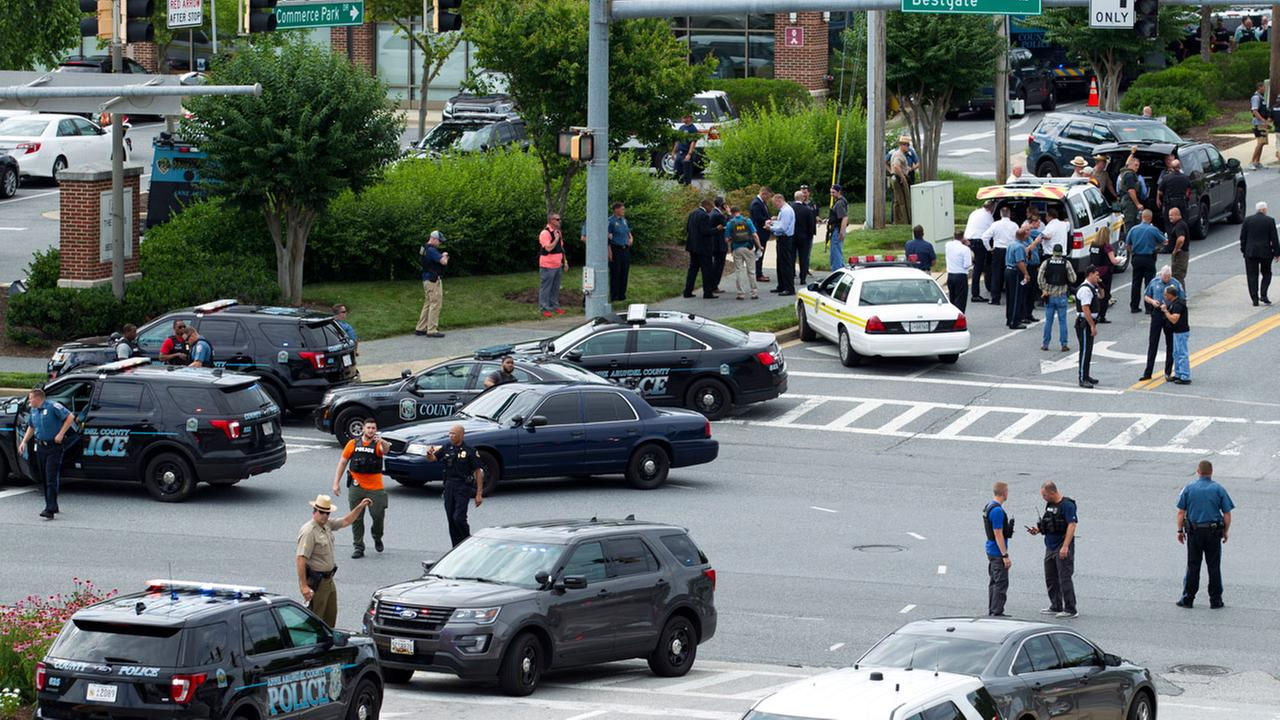 Maryland police officers block the intersection at the building entrance, after multiple people were shot at a newspaper in Annapolis, Md., Thursday, June 28, 2018.