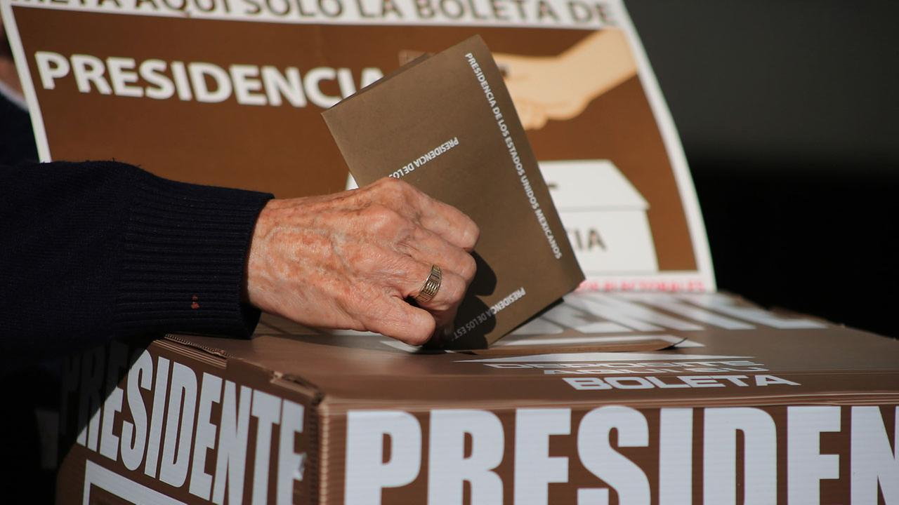 An elderly woman votes for president during general elections in Queretaro, Mexico, Sunday, July 1, 2018.