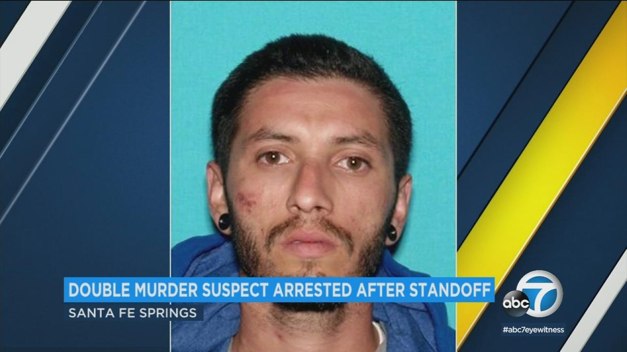 Authorities took a 29-year-old man into custody inside a Santa Fe Springs warehouse Saturday after he allegedly killed two men outside a motel in Downey.