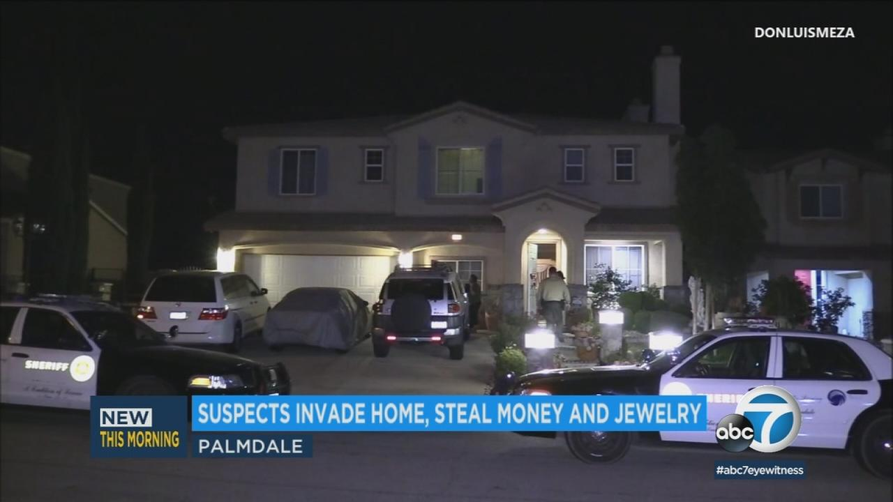 Three men stole a significant amount of cash and possibly jewelry from an occupied Palmdale home late Sunday night, authorities said.