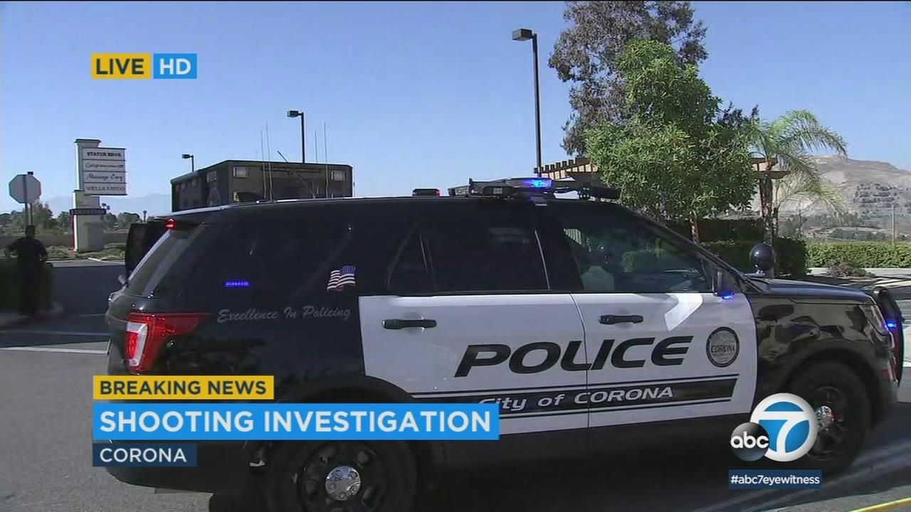 Authorities surrounded an area in the parking lot of a Corona Stater Bros. after a man was shot.