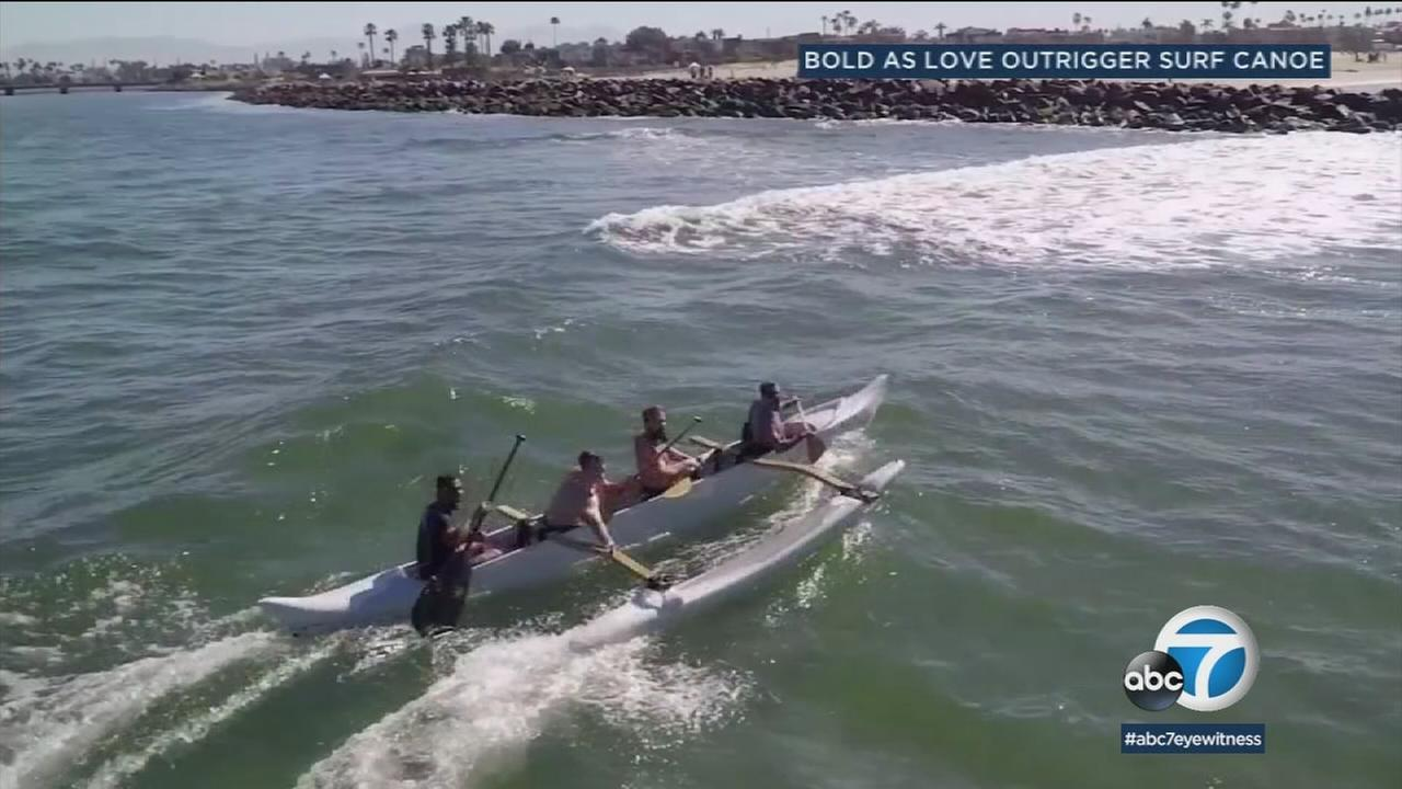 Footage from a Bold As Love Outrigger Surf Canoe piece is shown in a photo.