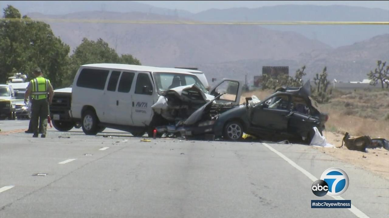 Four family members - two adults and two children - were killed in a two-vehicle crash in Palmdale on Tuesday, fire officials said.