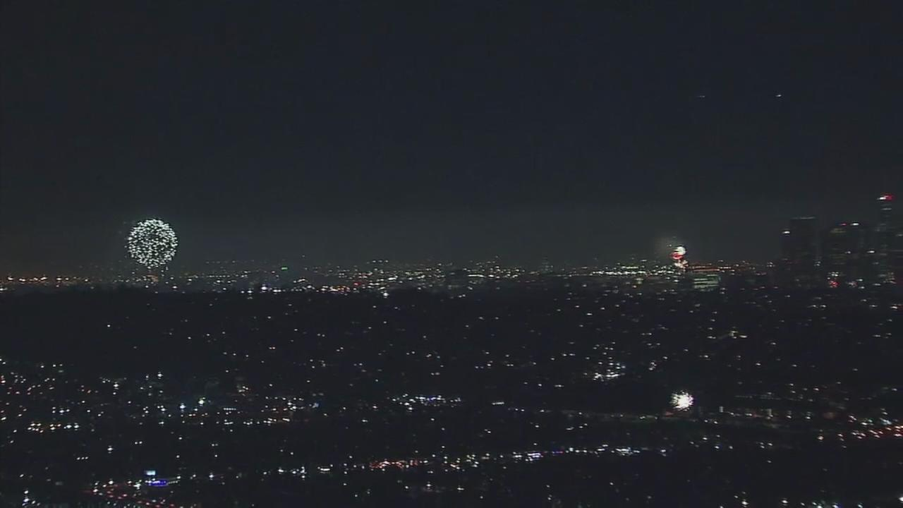 AIR7 HD captured dozens of illegal fireworks lighting up the skies over the city of Los Angeles.