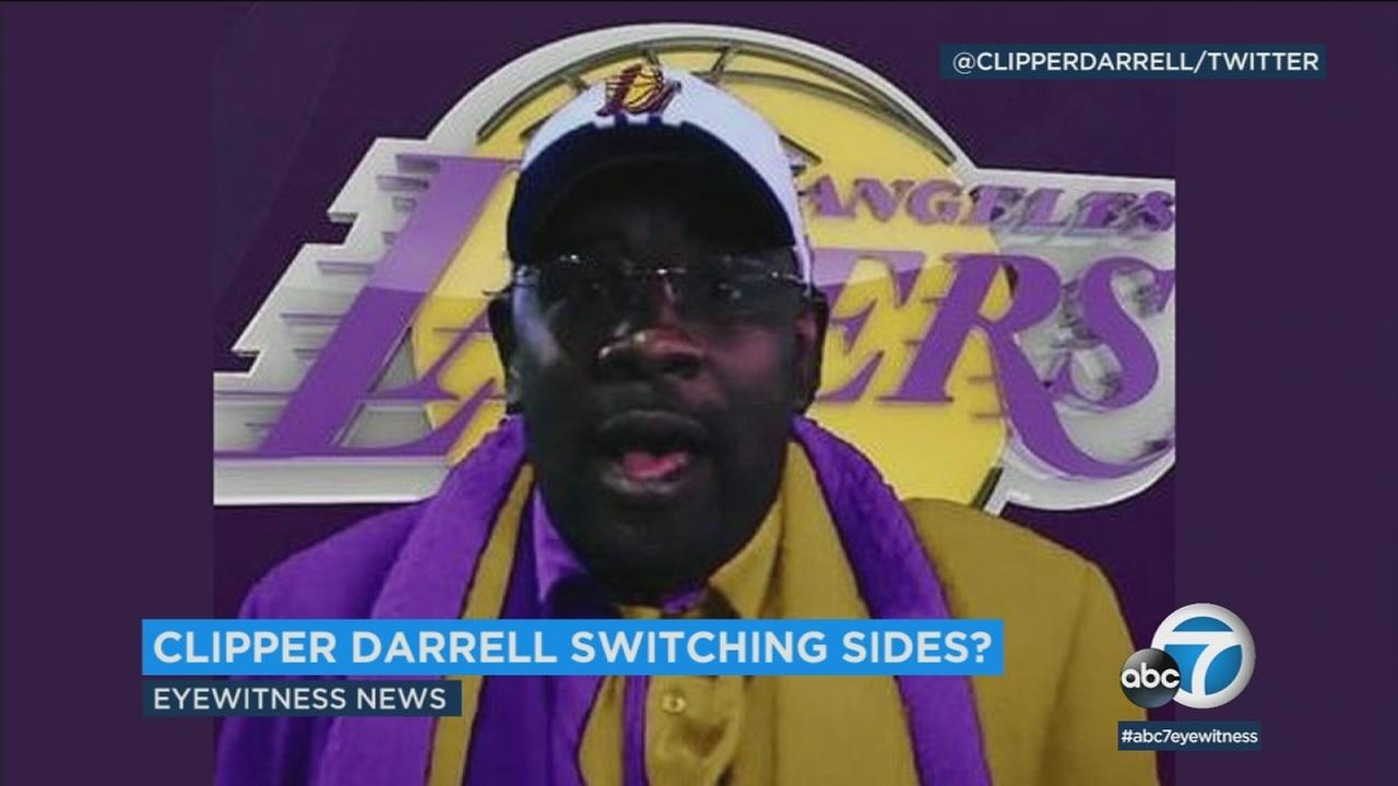 Superfan Clipper Darrell surprised fans in a purple-and-gold suit to praise the Lakers but says hes not actually switching loyalty.