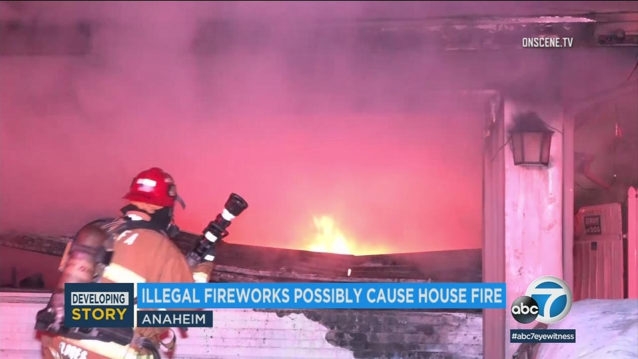 Fire officials say Fourth of July fireworks may have sparked a large house fire in Anaheim.