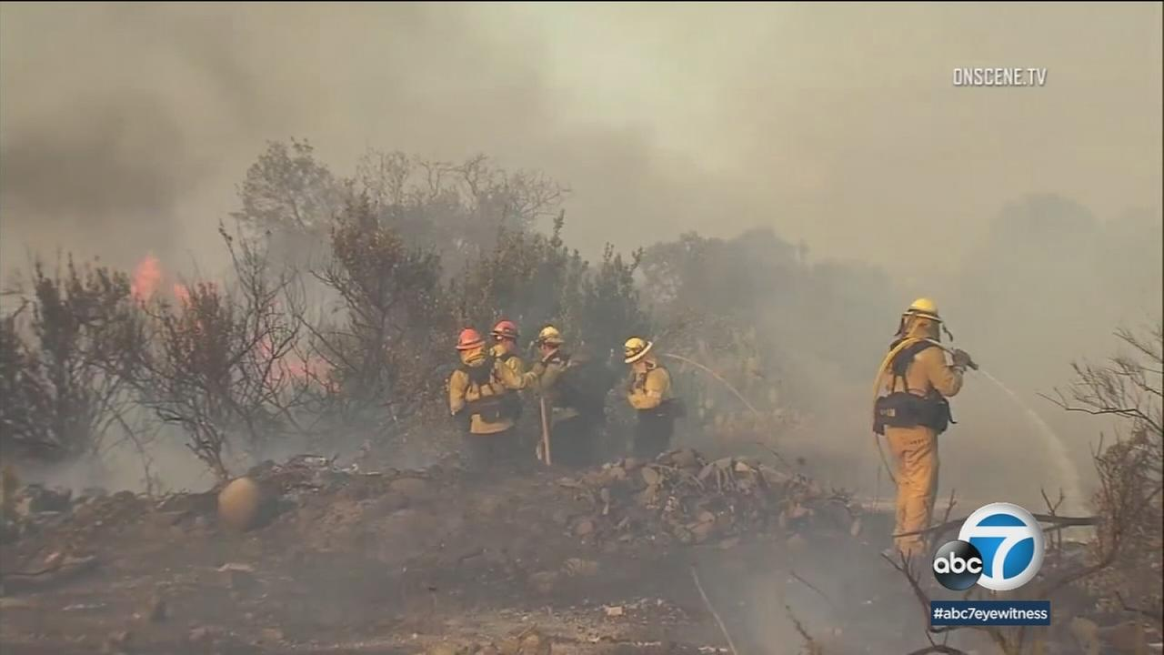 Firefighters across Southern California have been rushing to stomp out brush fires ahead of a blistering heat wave.
