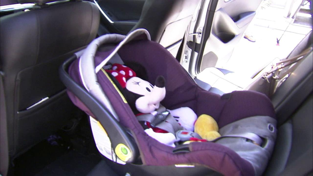 A Minnie Mouse doll is shown inside a carseat as an example of a child being in that seat during a hot day.