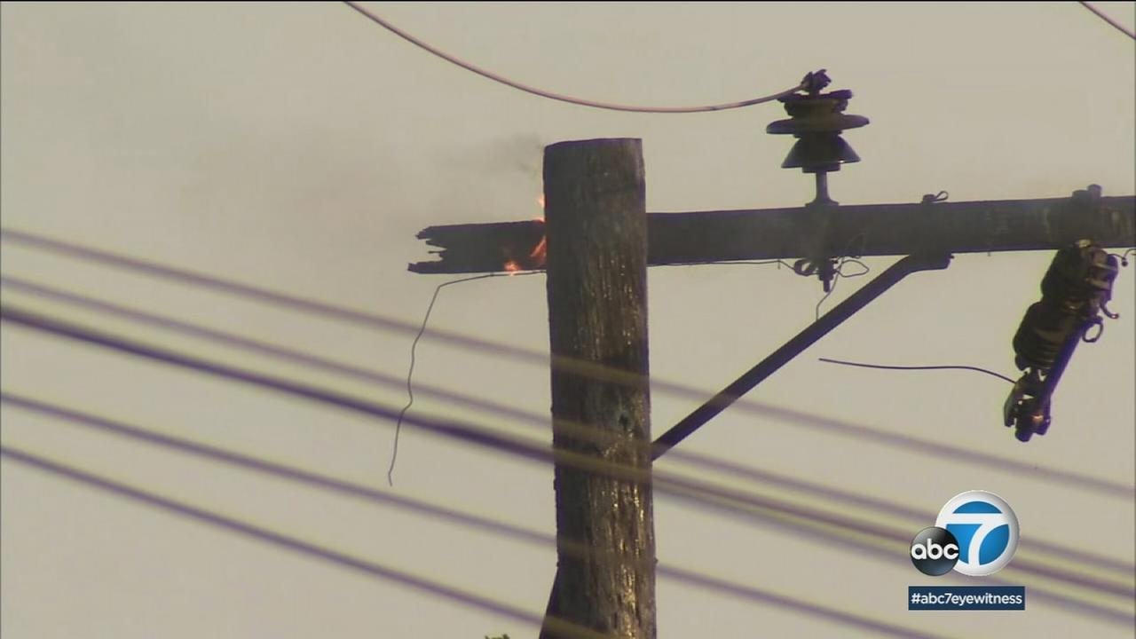 A small fire burned a power line after a transformer blew out from the strong heat covering Southern California.
