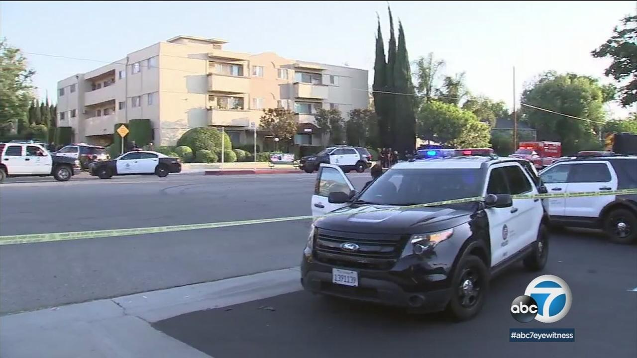 Authorities surrounded an area in Sherman Oaks after a former NBA and UCLA Bruins player barricaded himself inside a residence.