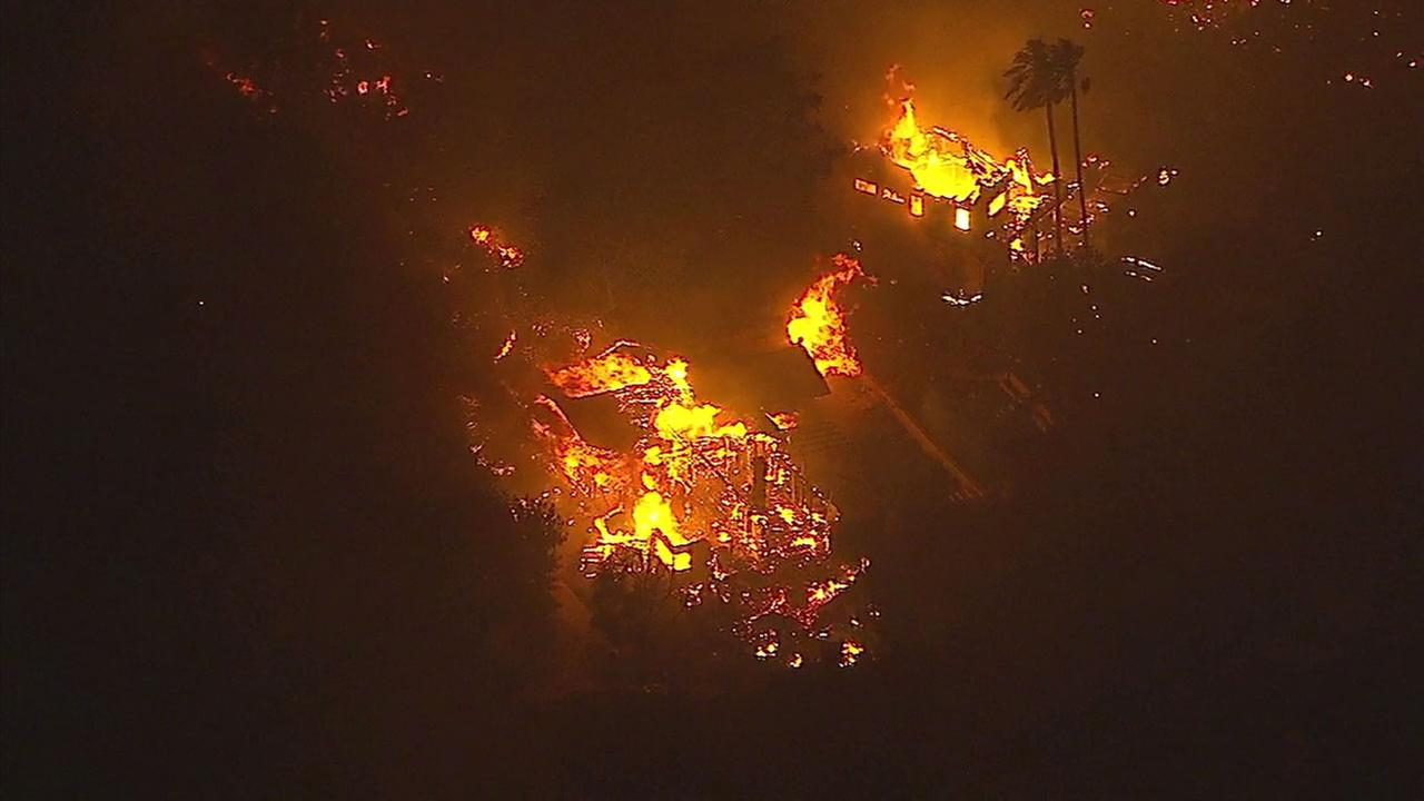 Two homes were covered in flames and destroyed by a wind-driven brush fire in Goleta on Friday, July 6, 2018.