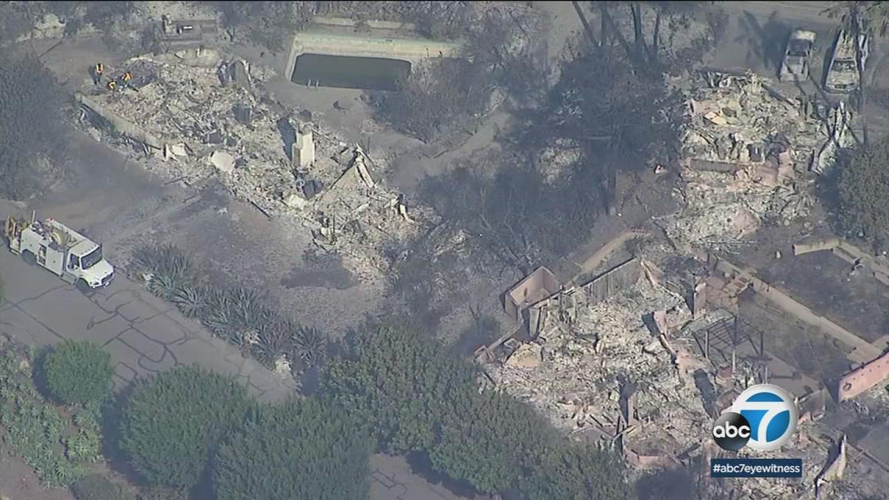The remnants of homes are shown in the Cathedral Oaks neighborhood of Goleta after a fast-moving blaze ripped through the area overnight.