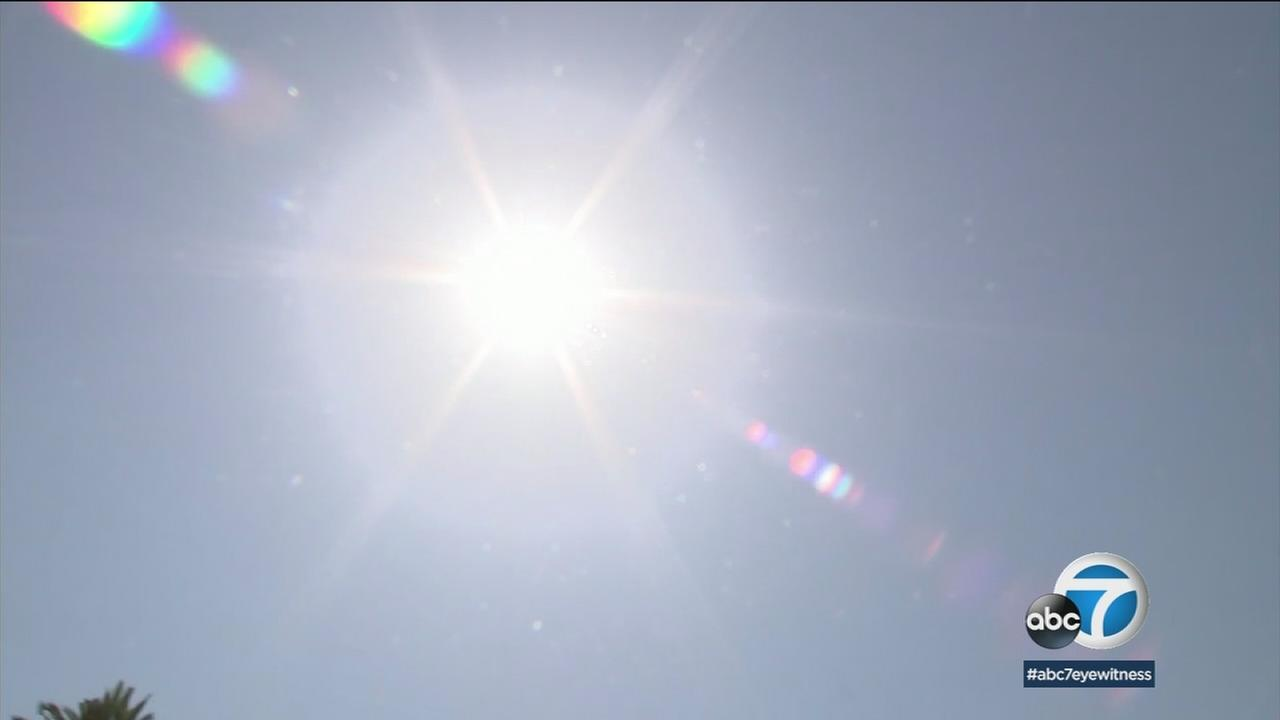 The sun is shown on a hot day in Southern California where thousands of people were left without power.
