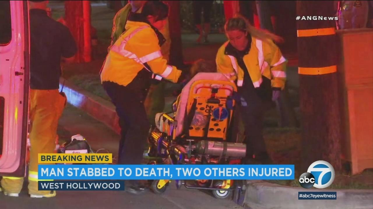A person is treated following a fatal stabbing in West Hollywood that left one man dead and two others injured on Sunday, July 8, 2018.
