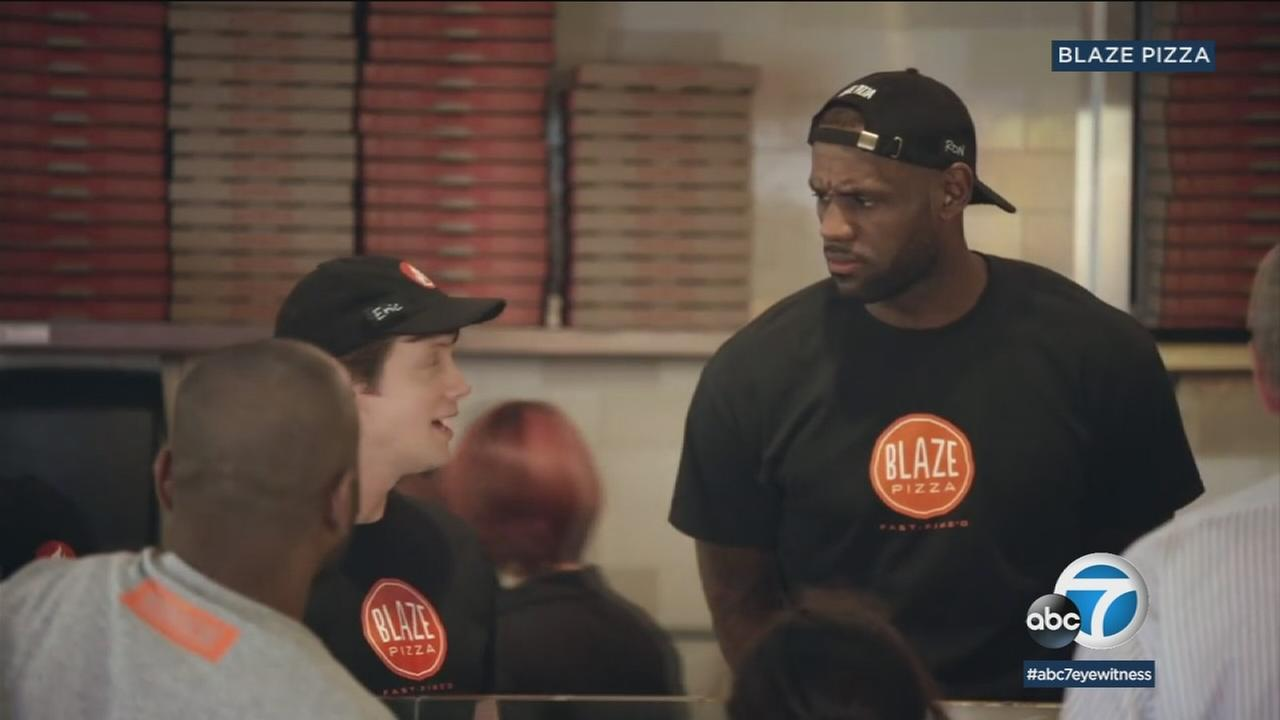New Lakers star LeBron James hinted that he might show up Tuesday at the Blaze Pizza in Culver City.