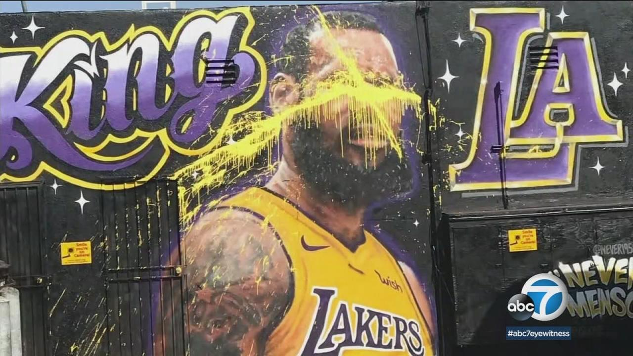A photo shows the second act of vandalism on a LeBron James mural outside of a restaurant.