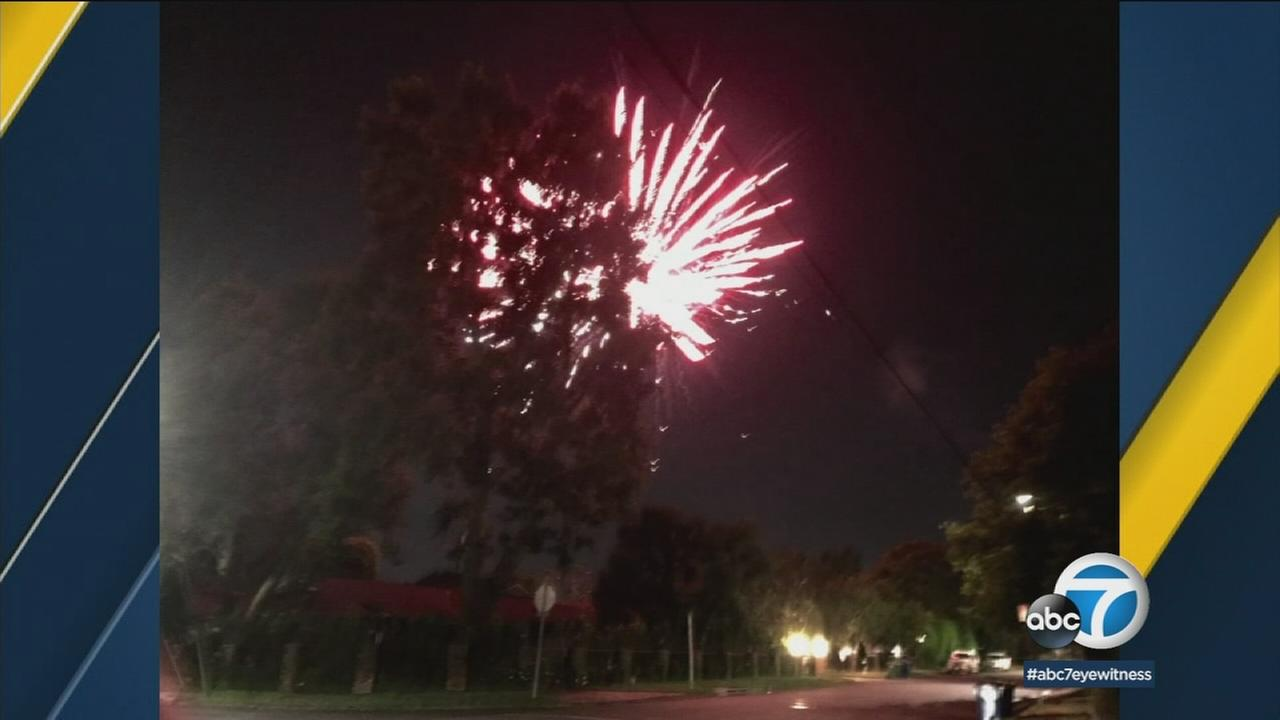 An illegal firework is shown being set off in a Los Angeles neighborhood.