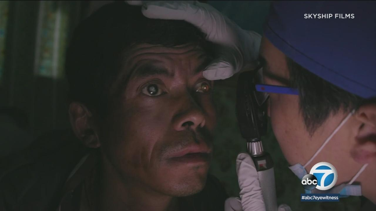 A man with cataracts is shown about to receive life-saving surgery in Nepal.