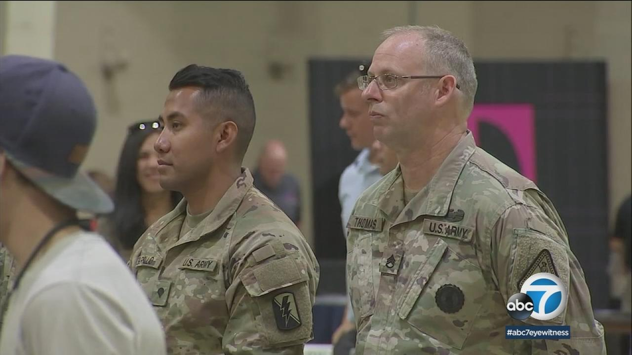 Veterans are shown at the Pomona Fairplex at a job exposition.